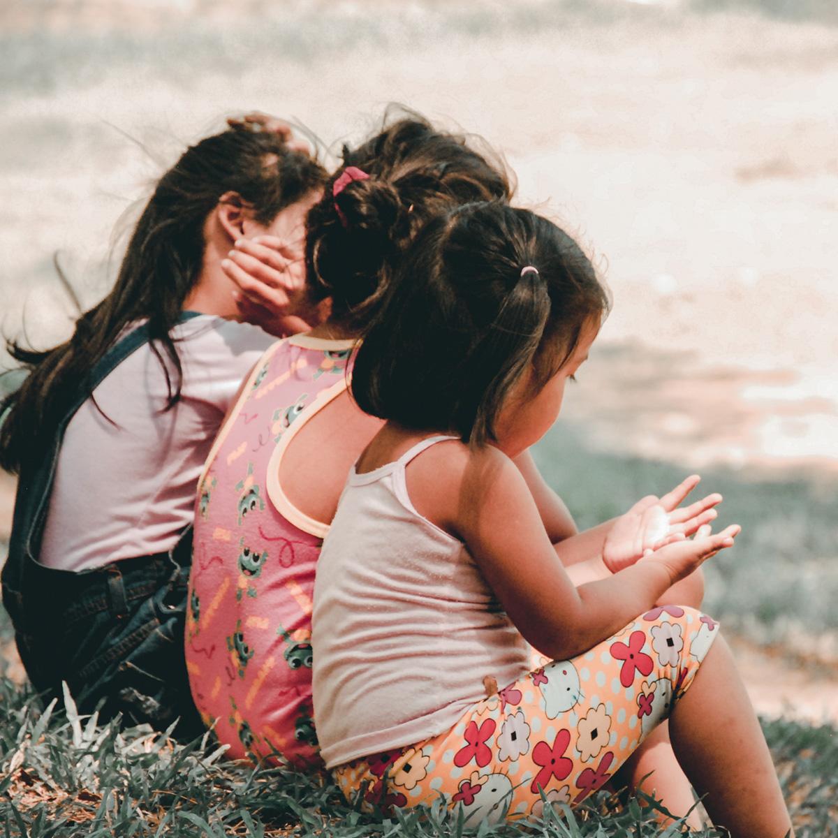 Children sitting down talking